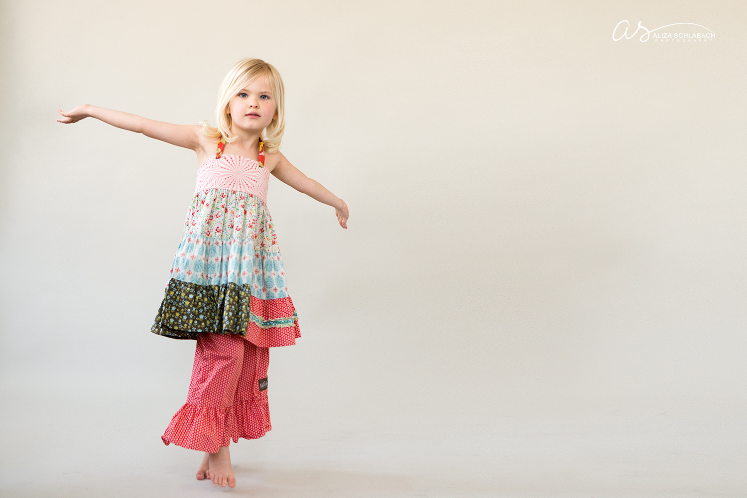 Portrait of a young blonde girl dancing in Matilda Jane clothing