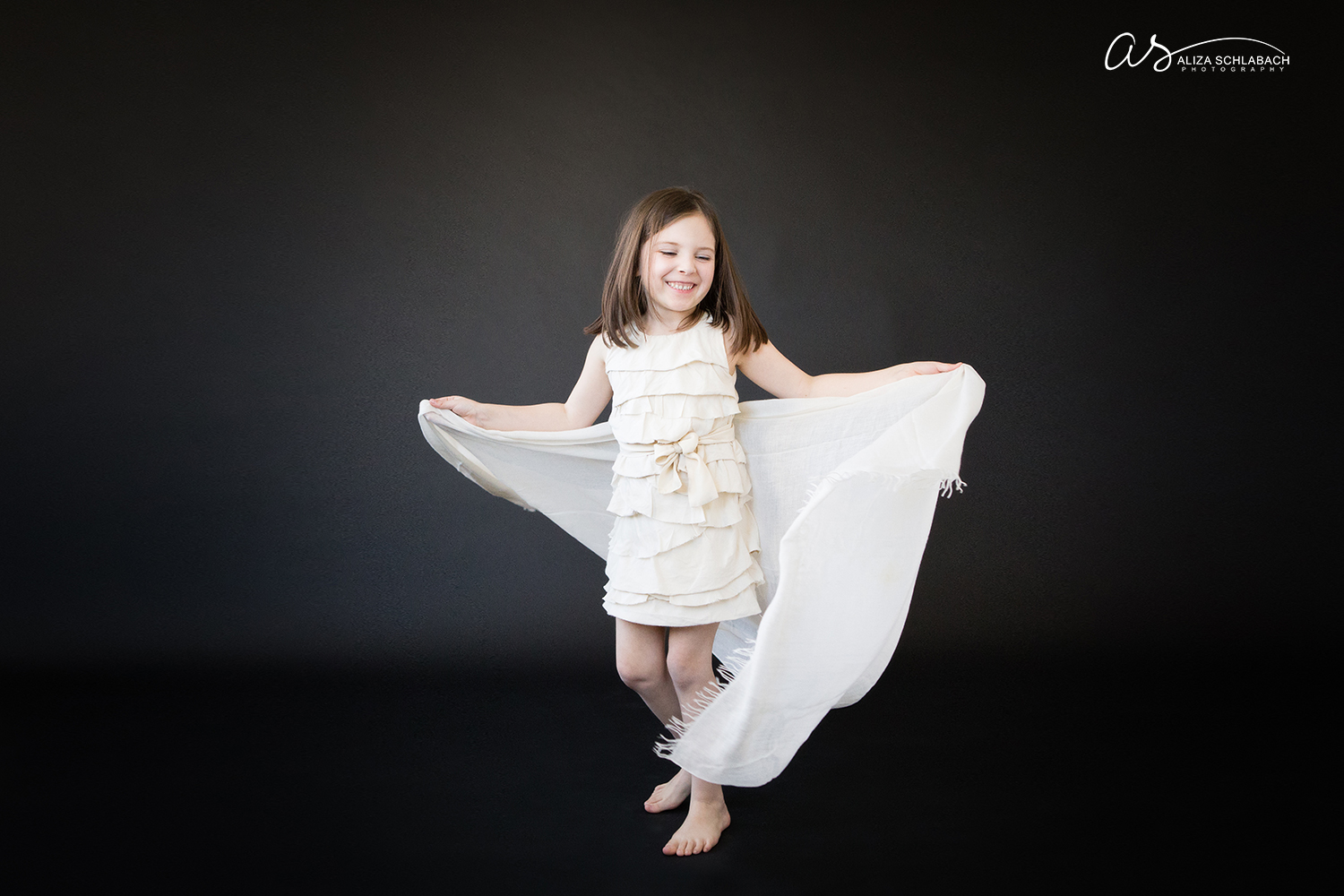 Photo of little girl dancing with a scarf