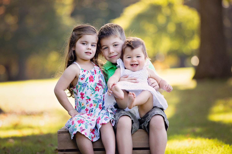 Fall portrait of three little kids