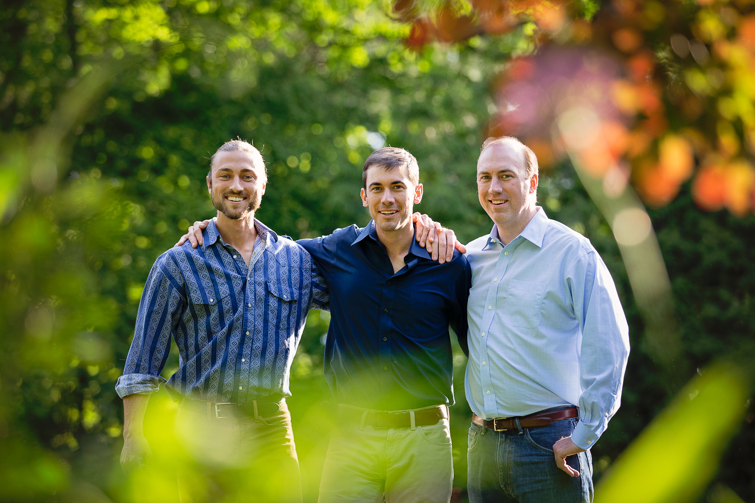 Outdoor portrait of three grown brothers