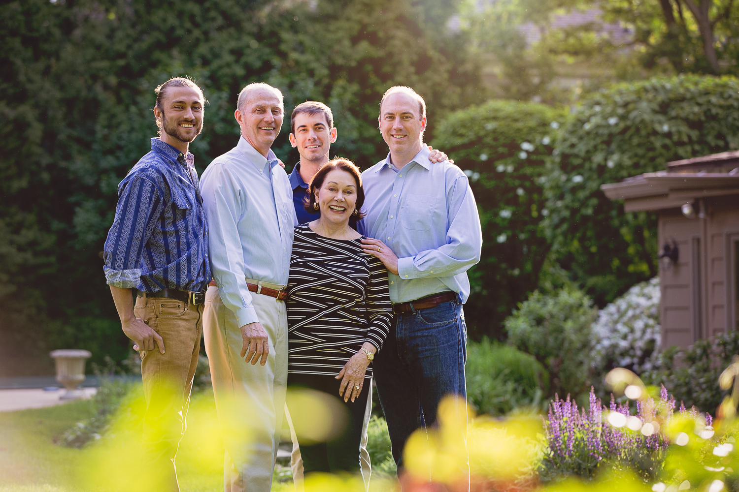 Outdoor portrait of a mature couple with their three grown sons