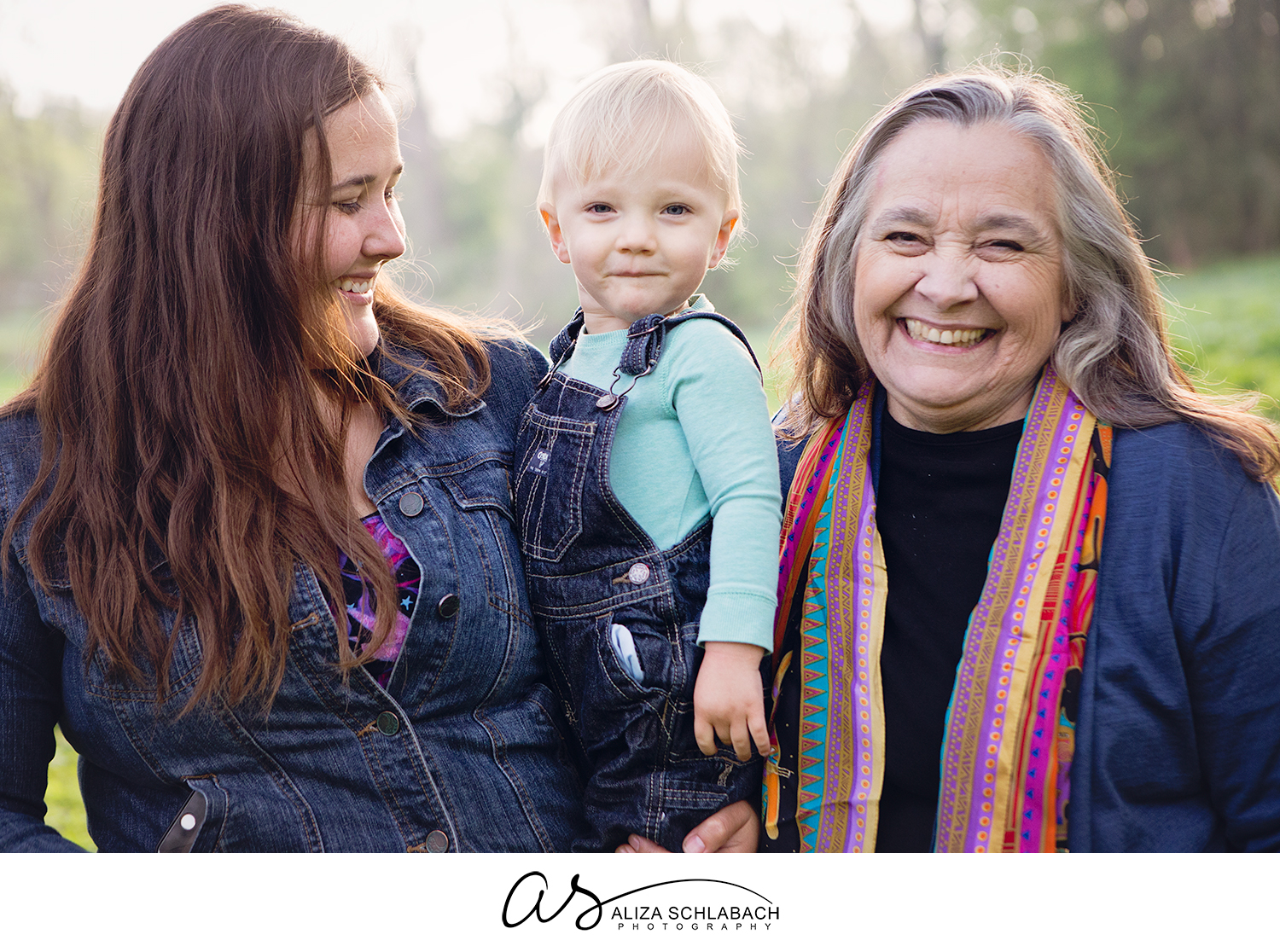 Happy portrait of a little boy with his Aunt and Grandma