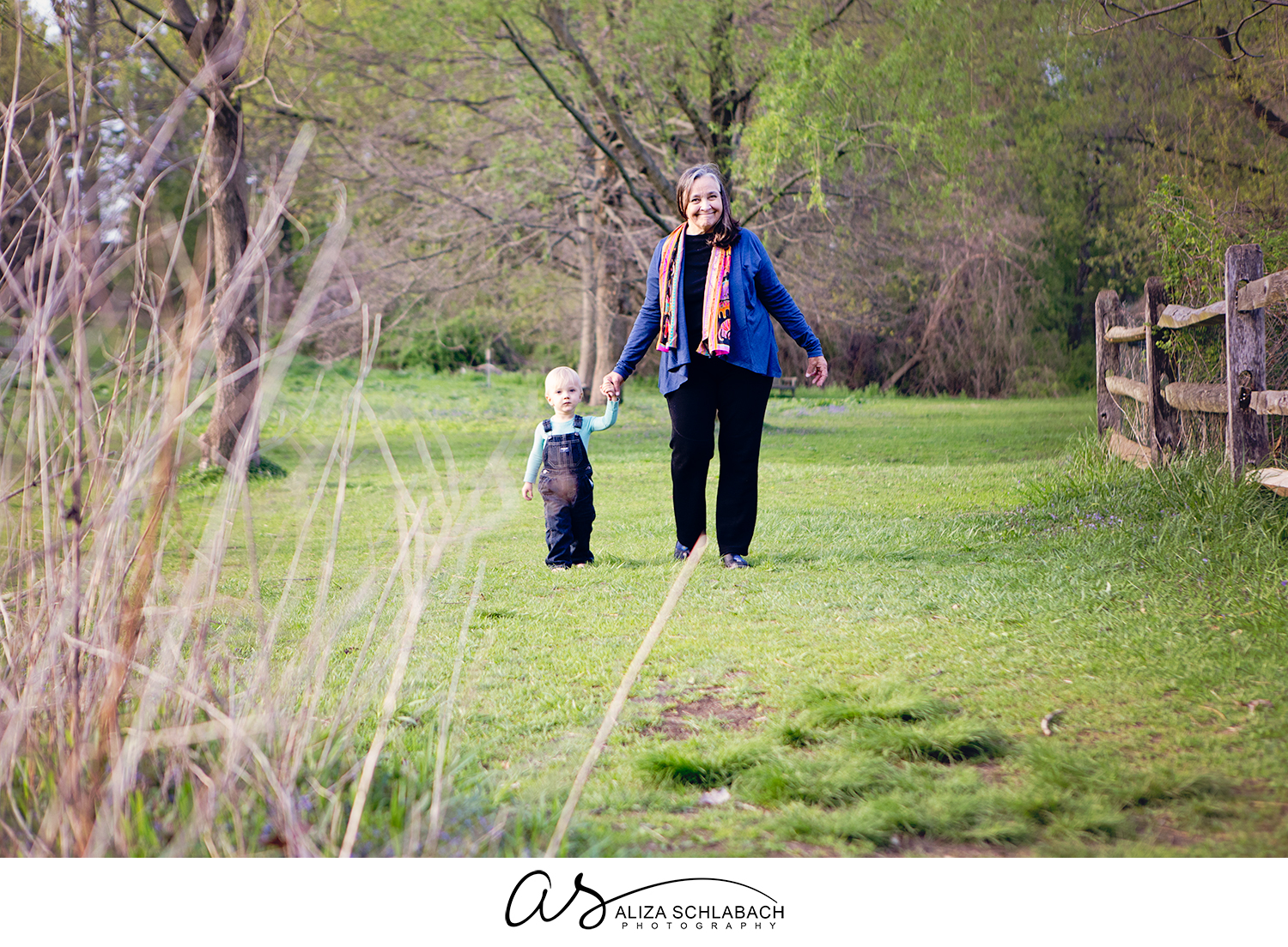 Outdoor family photo of a little boy and his grandma at Haverford College