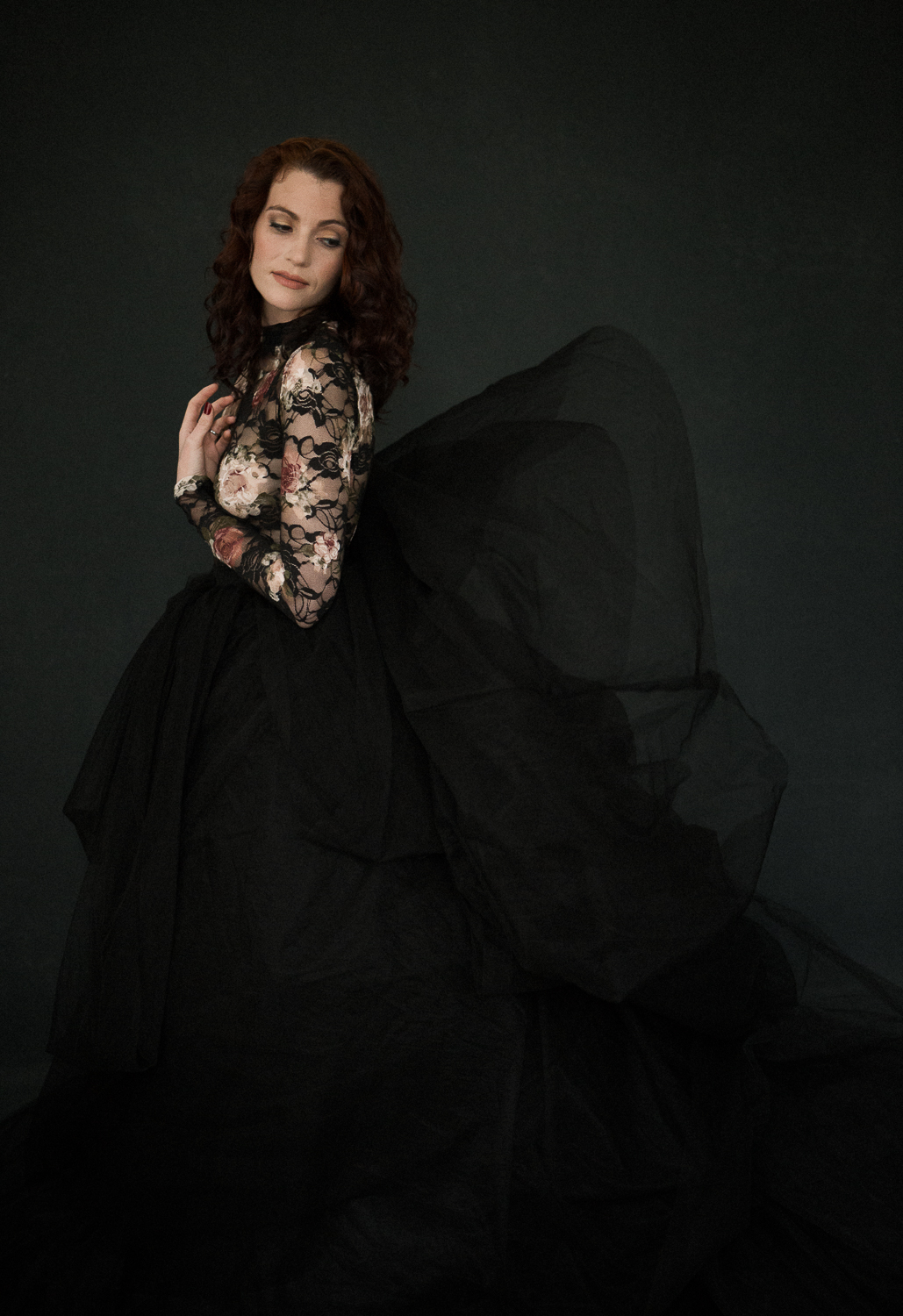 Dramatic portrait of a woman in a black tulle skirt