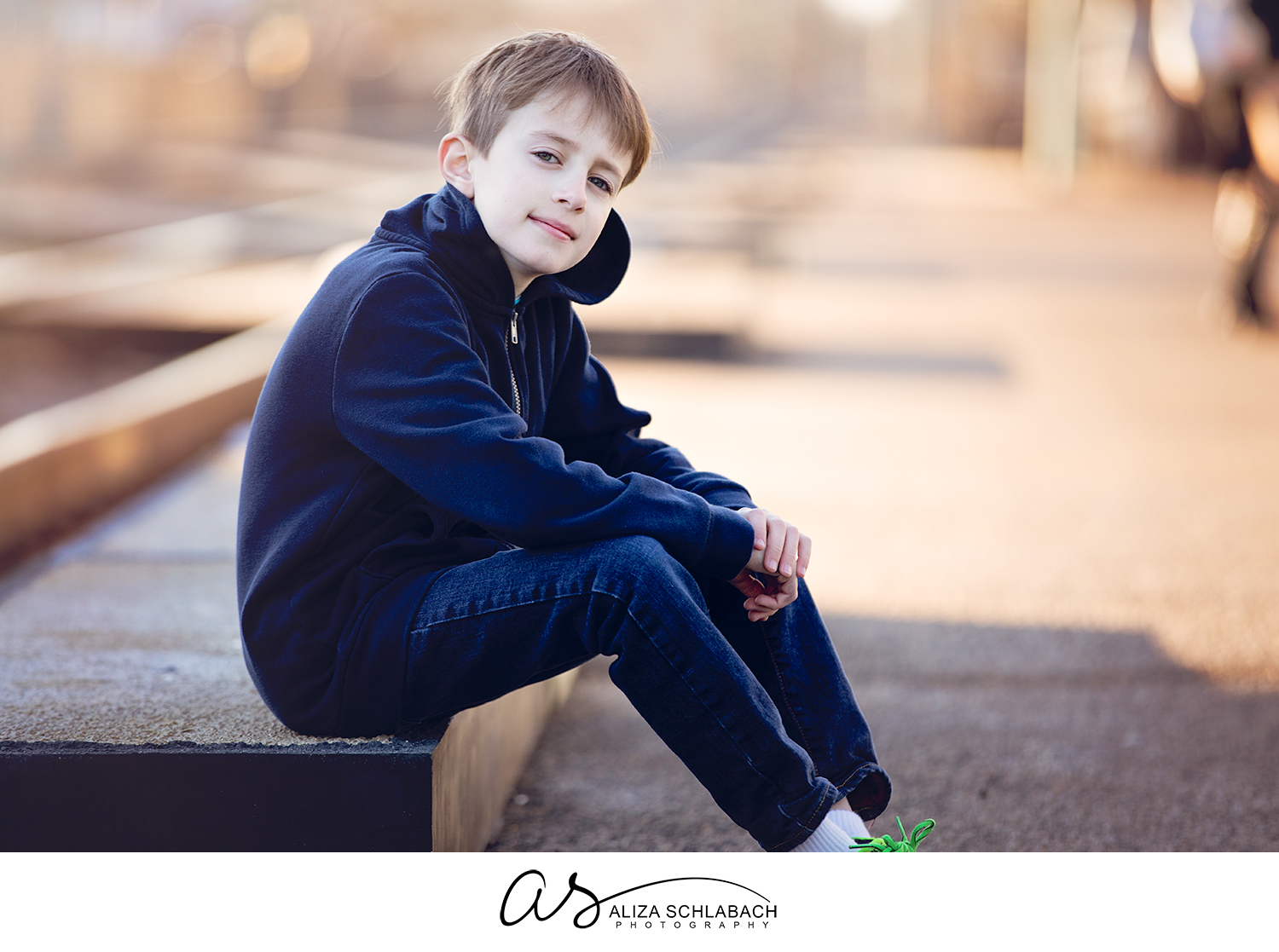 Photo of a boy sitting near the train tracks at Ardmore train station