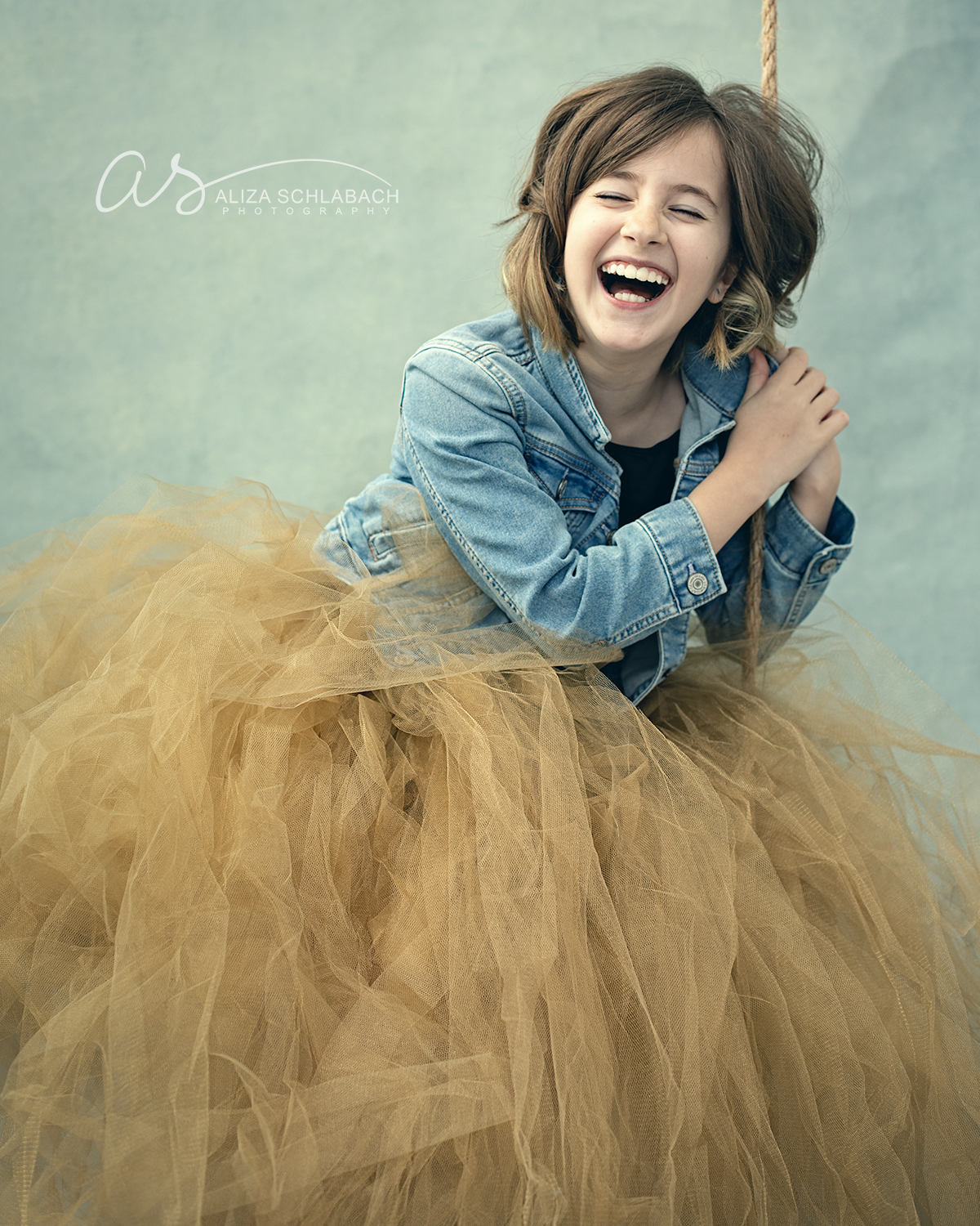 girl in tulle skirt laughing hysterically