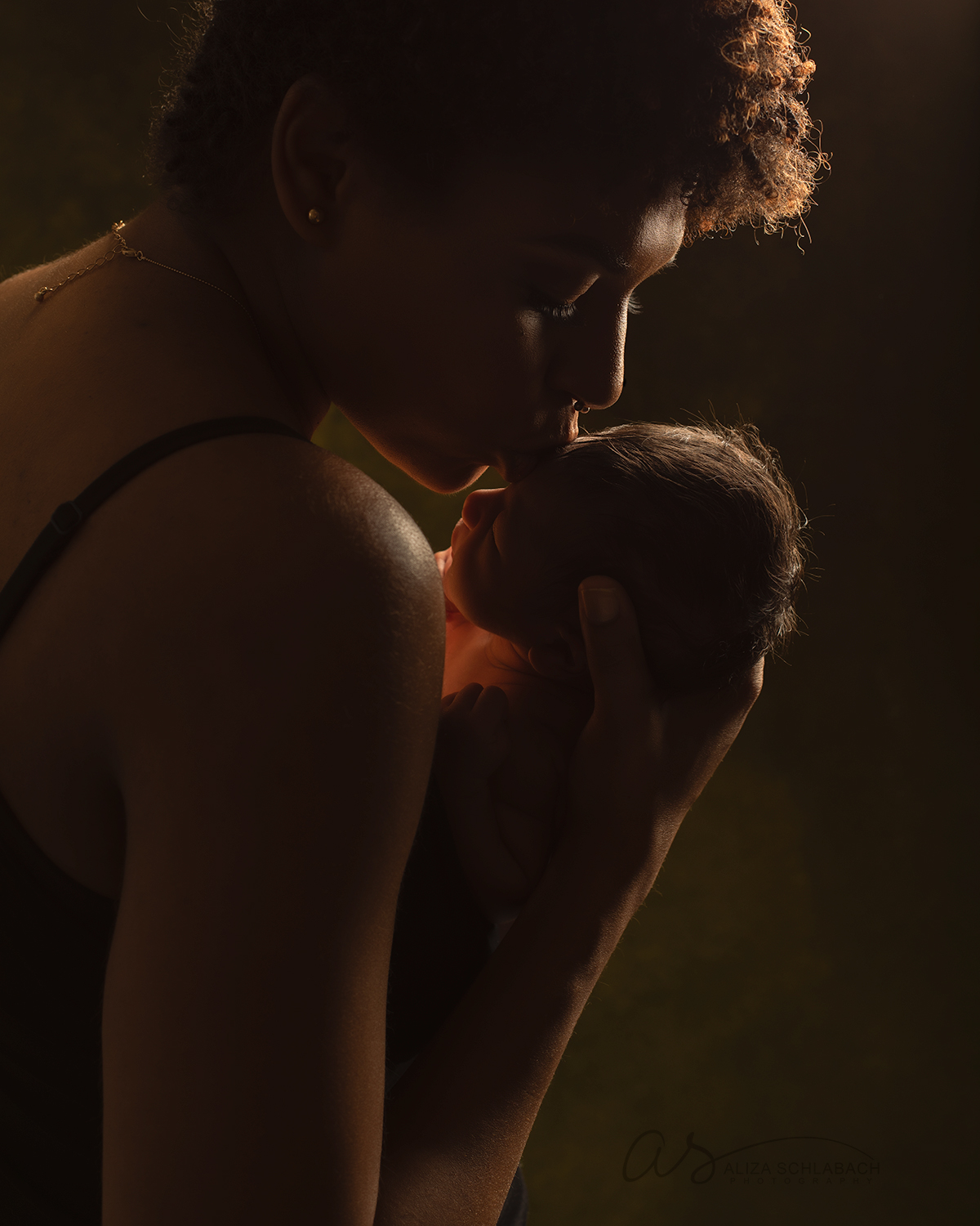 Newborn and mother silhouette