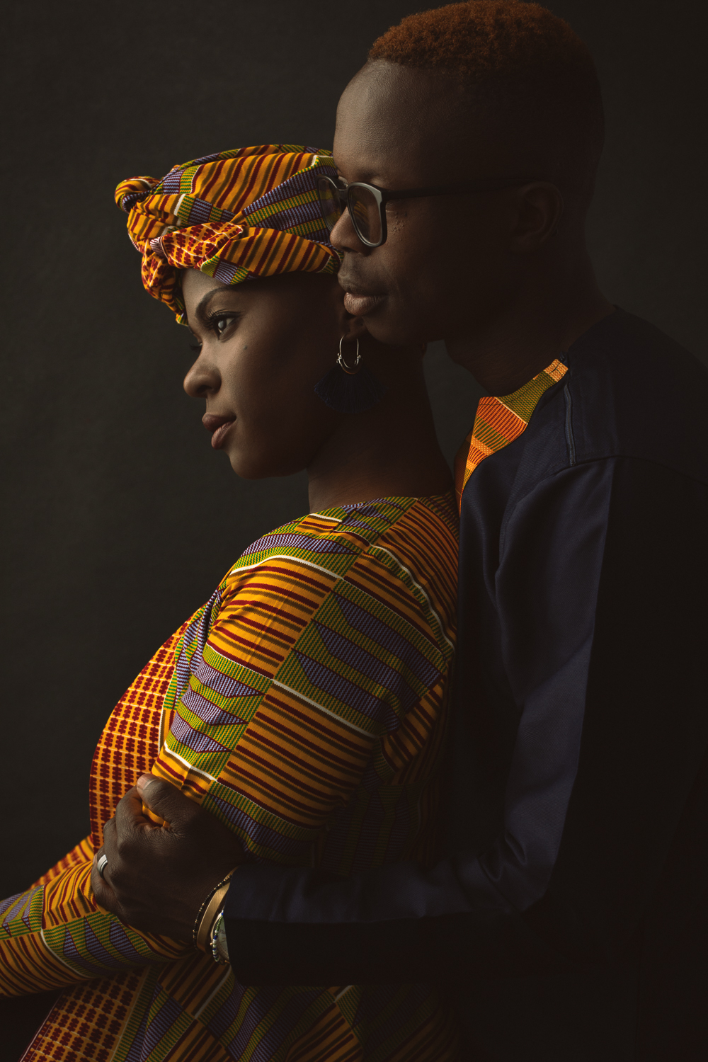 Dramatic portrait of a black couple wearing traditional African clothing