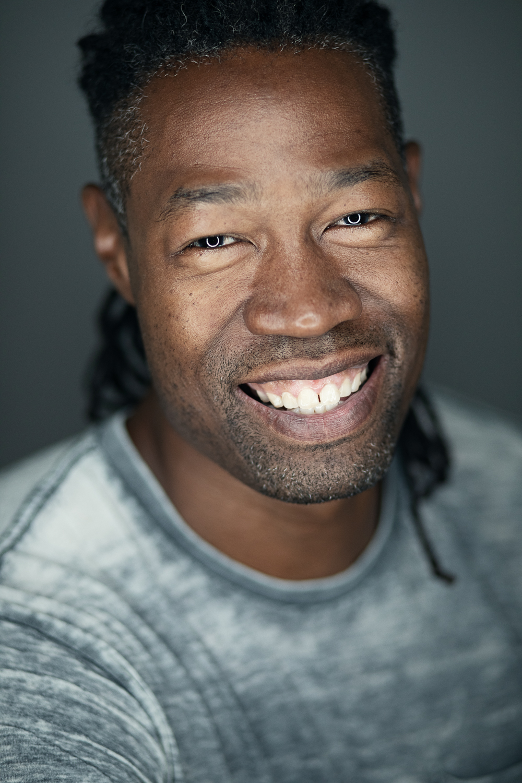 Ring light headshot of a smiling black man