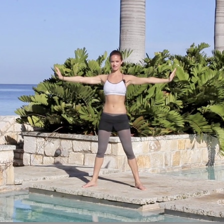 Sahra elongates her arms to create more weight for toning them.