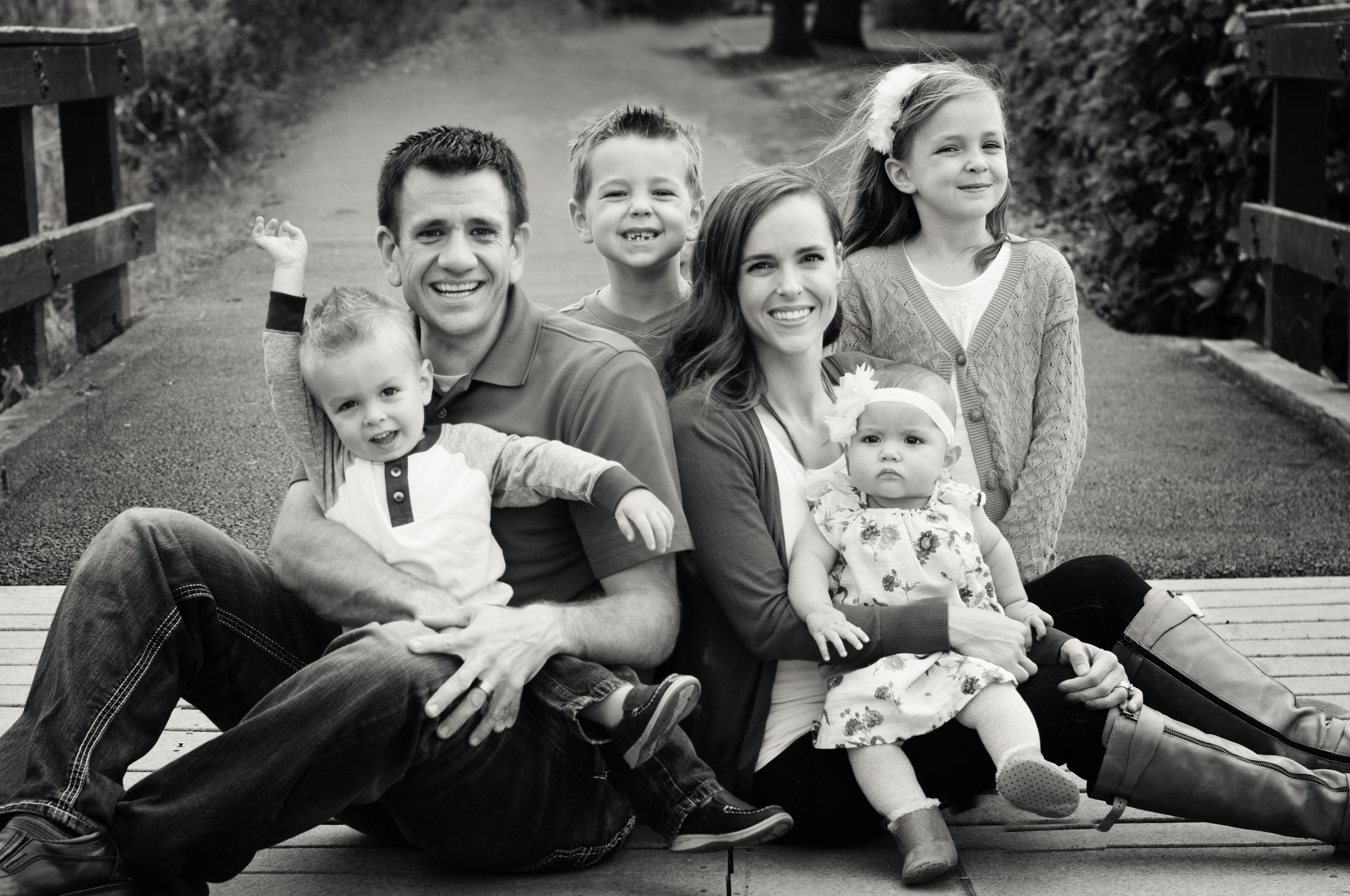 McBride Family-sitting on the bridge platinum.jpg