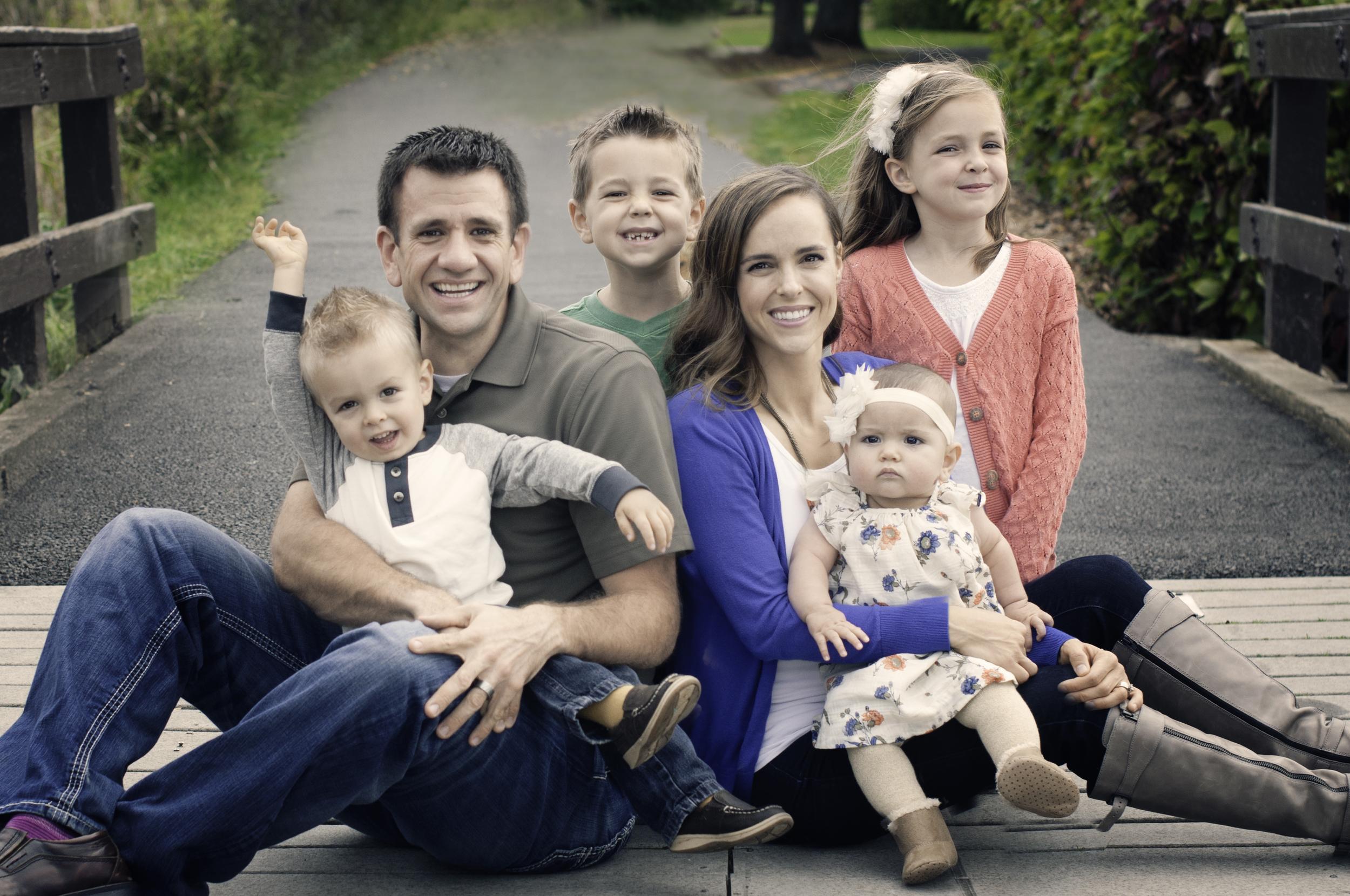 McBride Family-sitting on the bridge.jpg