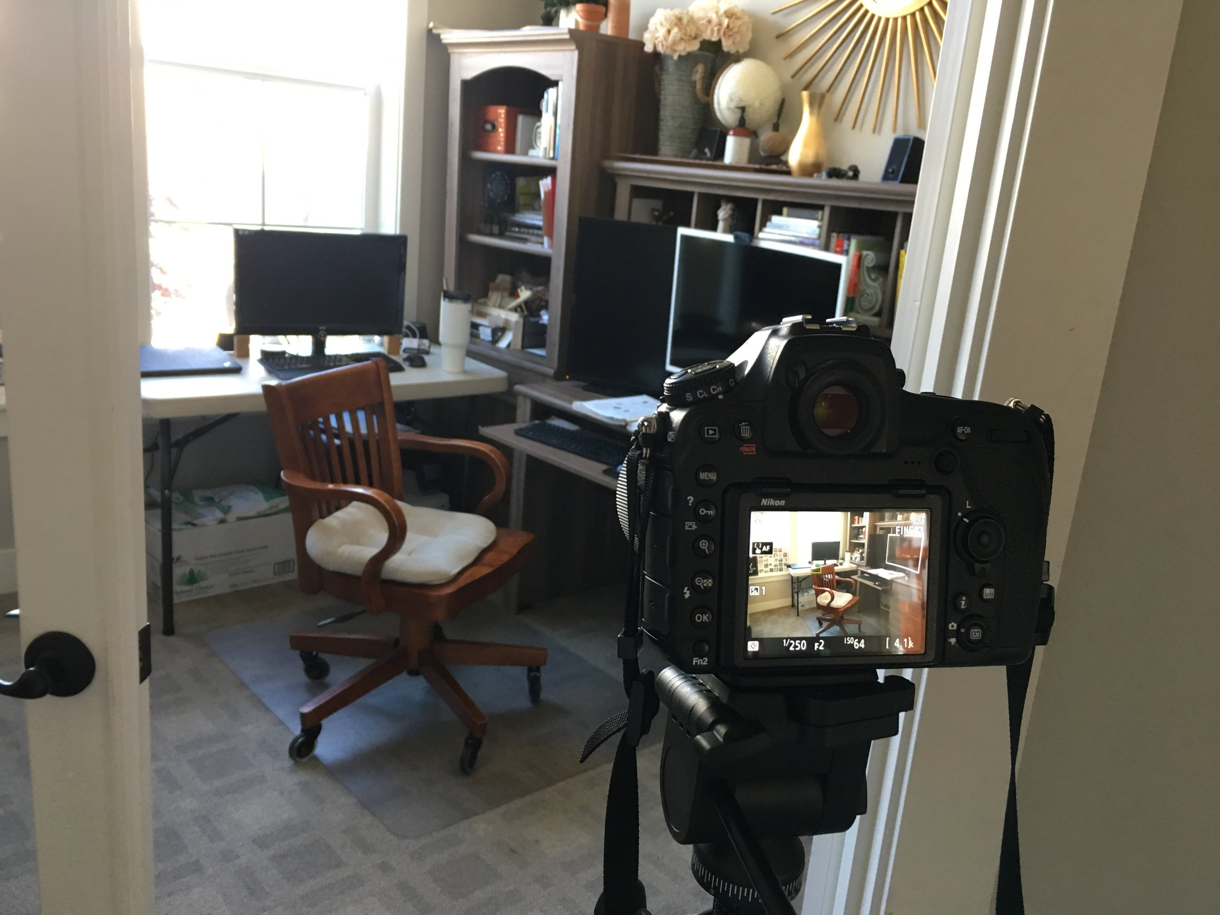 I am always in my office editing, writing, budgeting, marketing, etc. I just set up my tripod, got the settings how I wanted them and used the timer to get in the picture.