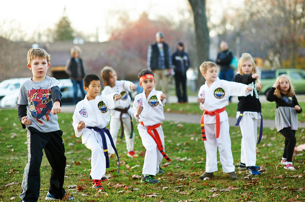 The Karate kids and tiny tigers know demonstrate exceelence in their focus in practing deep stances. deep stances help us maintain balance so we do not fall over like weak tree roots can topple a tree.