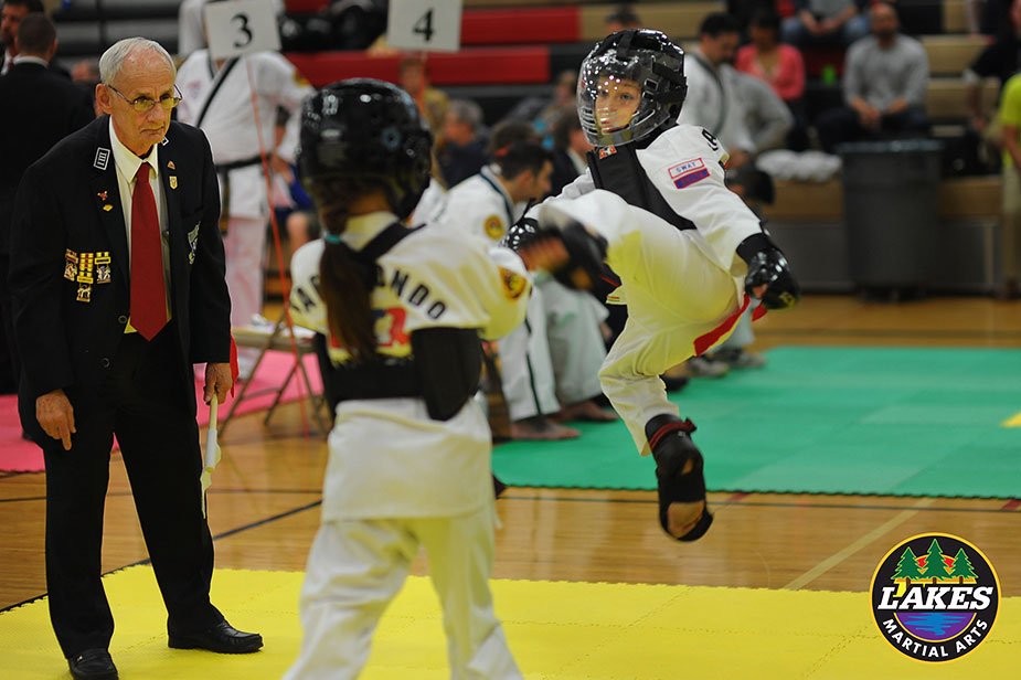 Lakes Martial Arts student, Sylvi, executes a jump front kick to score her first point in sparring at her first tournament. I expect this to be the first of many more points to be earned.