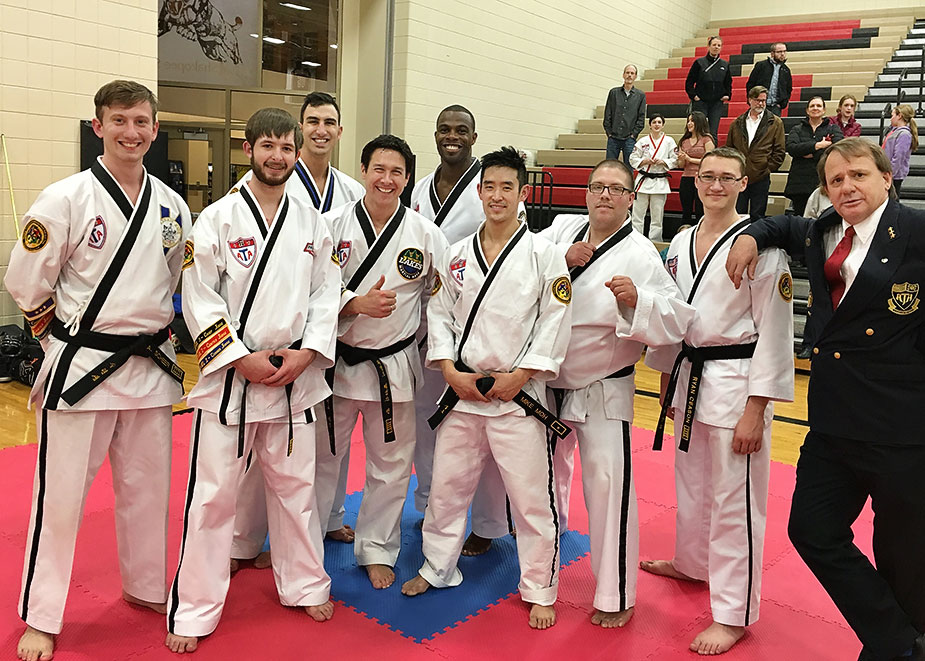"""A wonderful group of fourth and fifth degree black belts in a combined Men's ages 17-29 and 30-39 division at the Twin Cities Regional Tournament hosted by Sr. Master Gleisner. What a wonderful experience to have fun. Special thanks to Mr Jharen Haynes for his tutelage on the """"cane"""" form."""