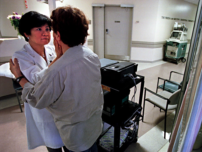 ...and then things change. A heatwave in NYC forces a power outage, cancelling all elective surgeries at Columbia-Presbyterian Hospital about 40 blocks uptown from Mt. Sinai, which still has power. In this photo, Joan is being told that a heart, which could not be transplanted into a patient uptown, was at that time in a taxi on its way down to Saul.