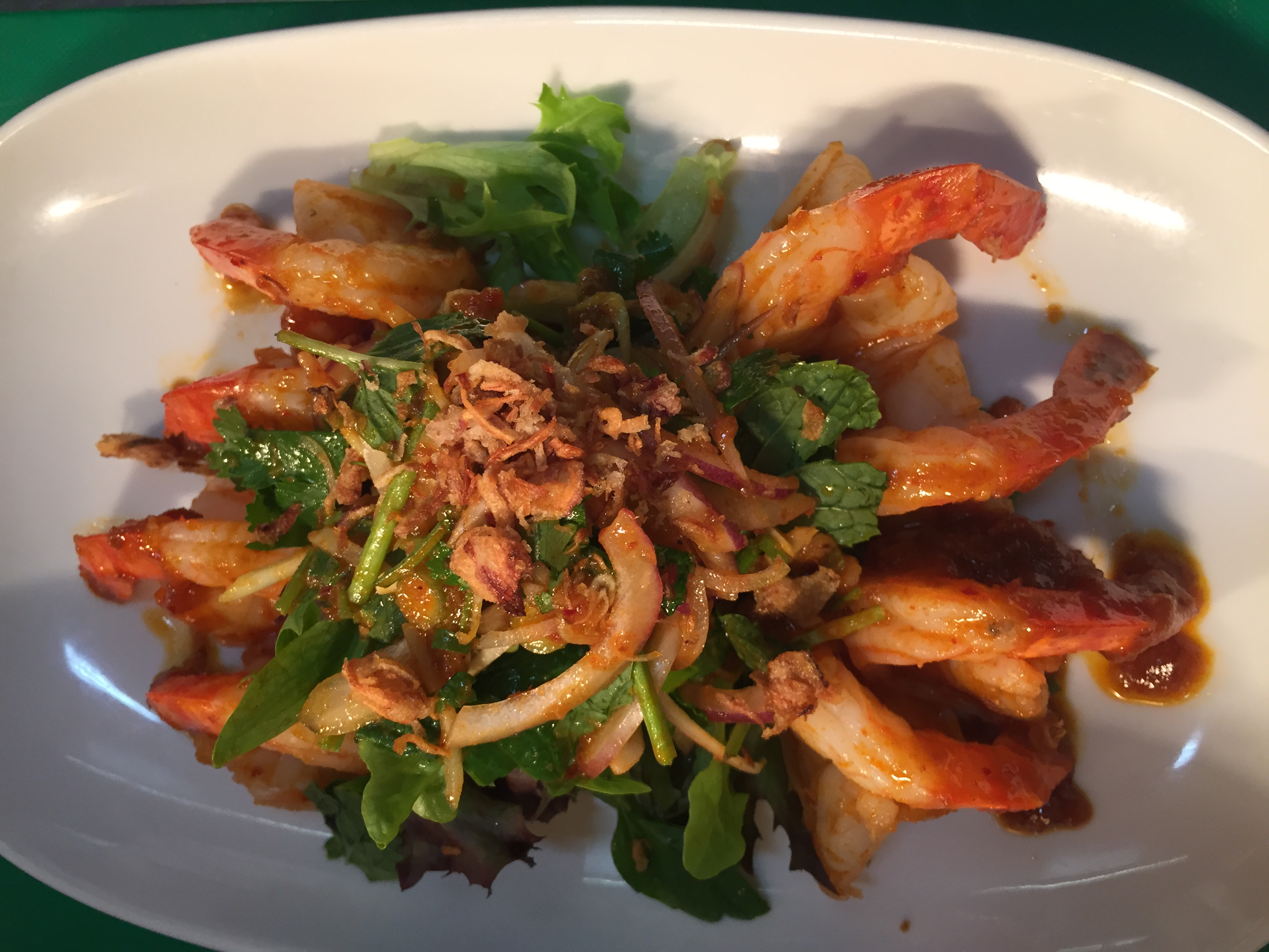 Pla Goong Crunchy seared prawns topped with ginger, lemongrass, coriander, spring onion, chilli, lemon juice and fish sauce.