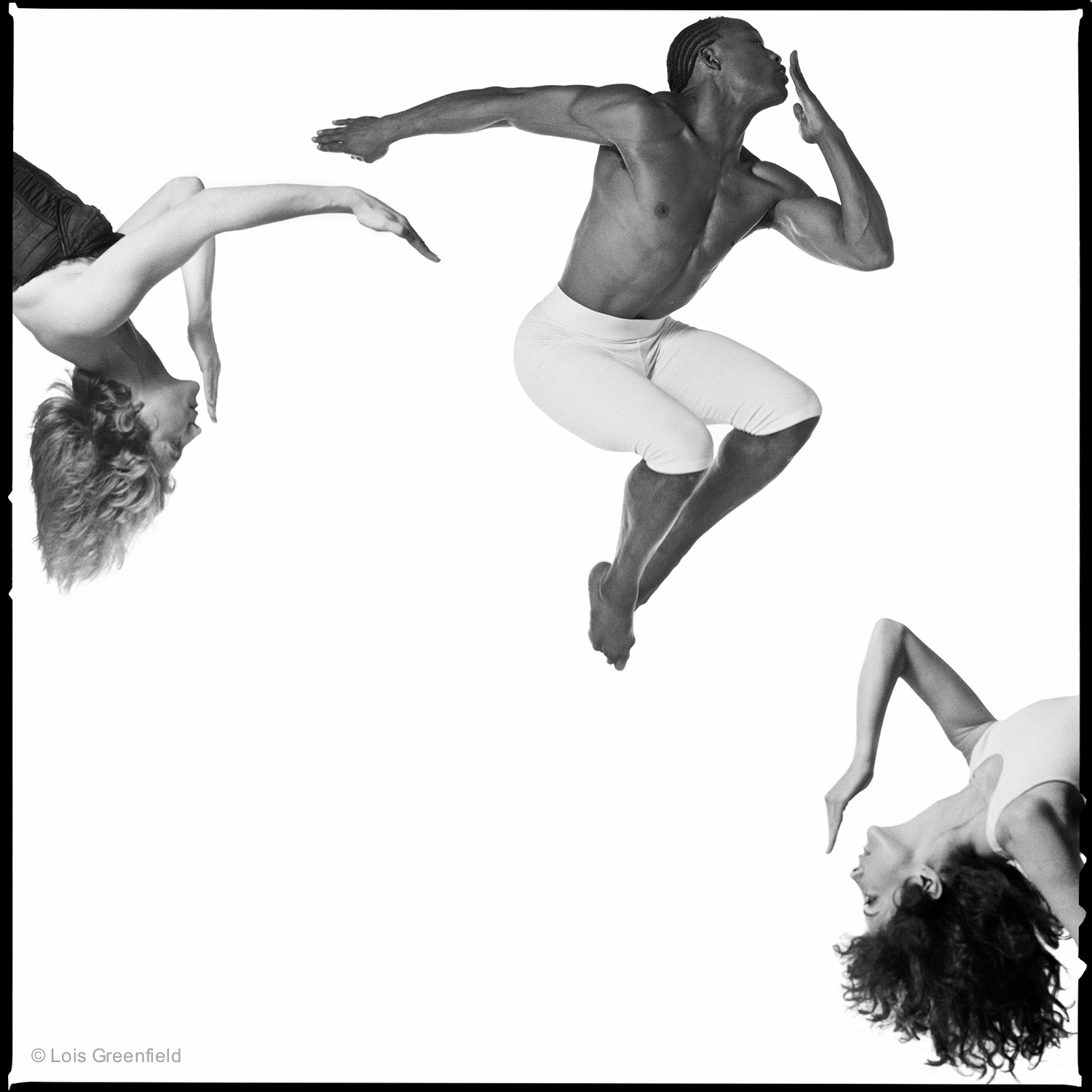 "JANET LILLY, BILL T. JONES, HEIDI LATSKY, "" Chatter"",  BILL T. JONES/ARNIE ZANE DANCE COMPANY   I never use photoshop to combine or rearrange the dancers in my photos. In this shot the two female dancers are each leaning backwards into the frame, which cropped out the ladders they were hanging from."
