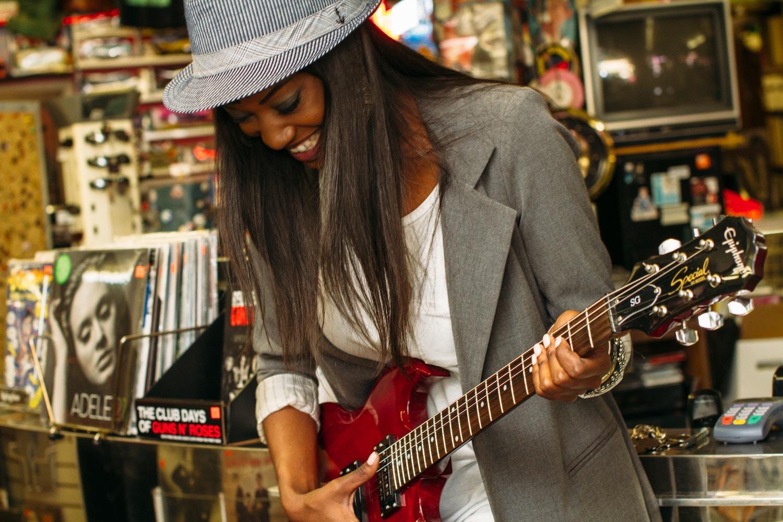 girl-having-fun-playing-guitar.jpg
