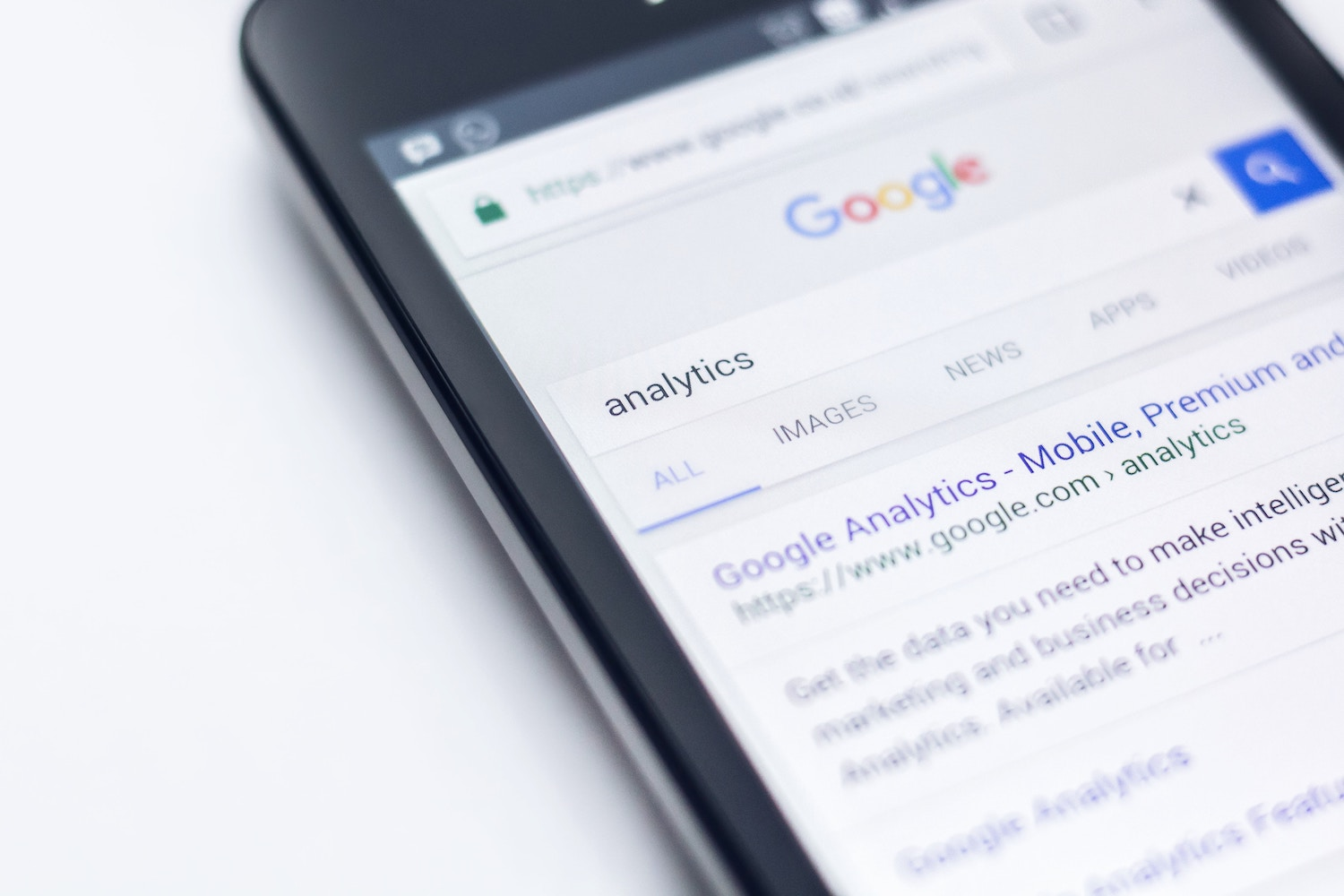 """Google search result for """"analytics"""" on a smartphone"""