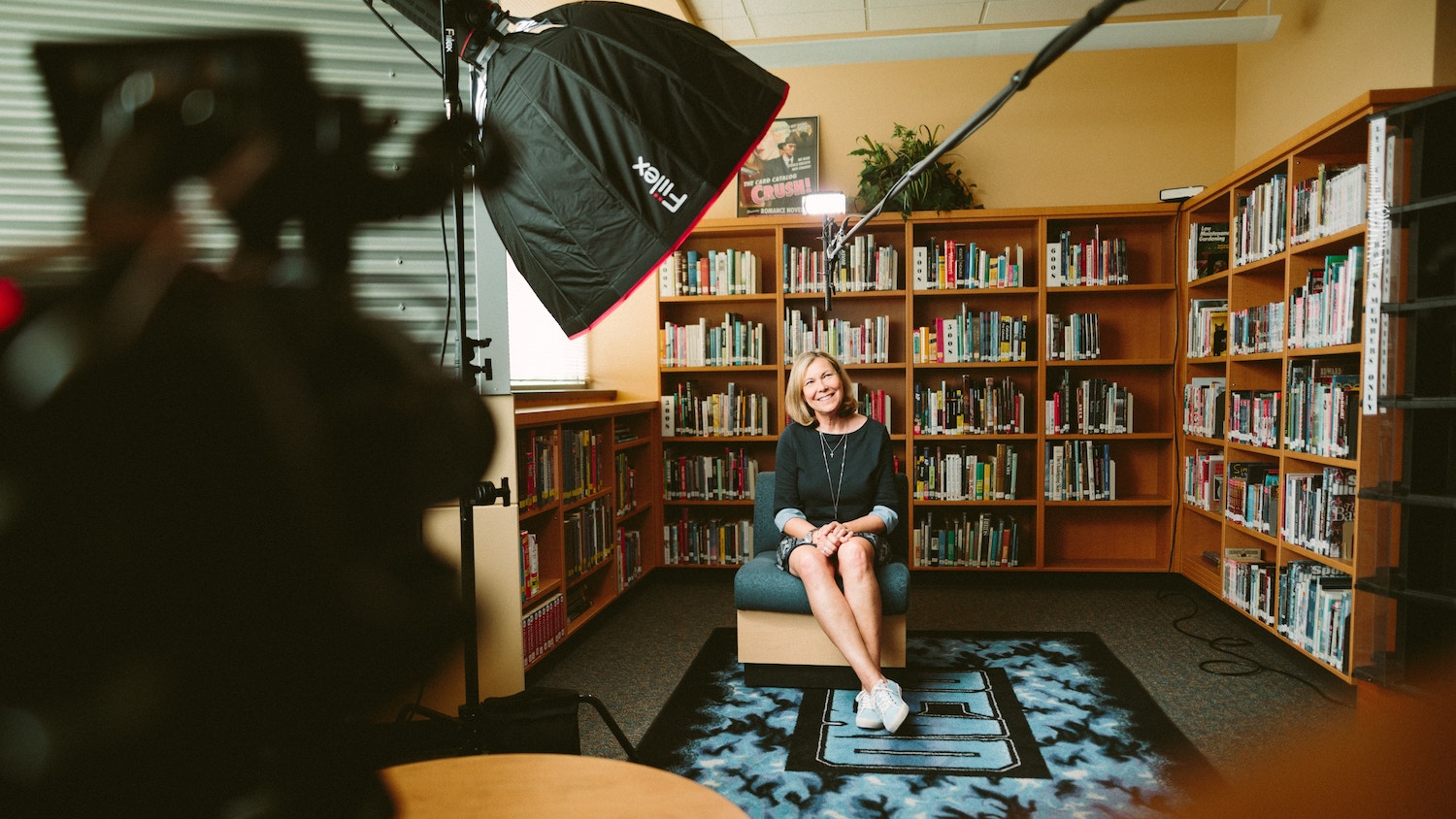 local business owner shooting a video in a library