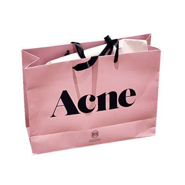 "Image and Caption by thecut.com 2007 : Acne Studios debuts its  pink shopping bag.  Jonny Johansson says he was inspired by ""a pink sandwich-wrapper paper lying on my desk."""