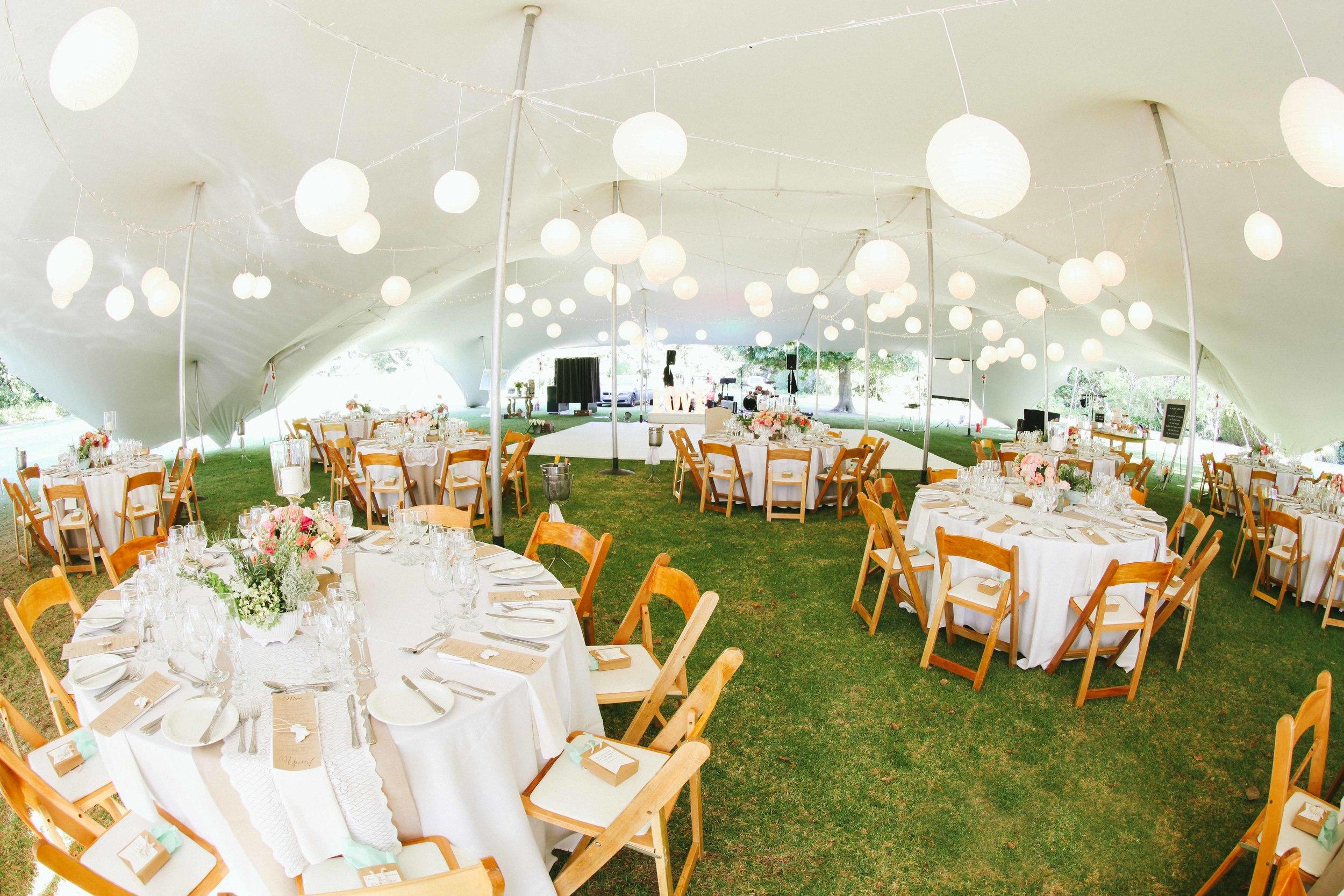 Outdoor Wedding Reception Under A Tent