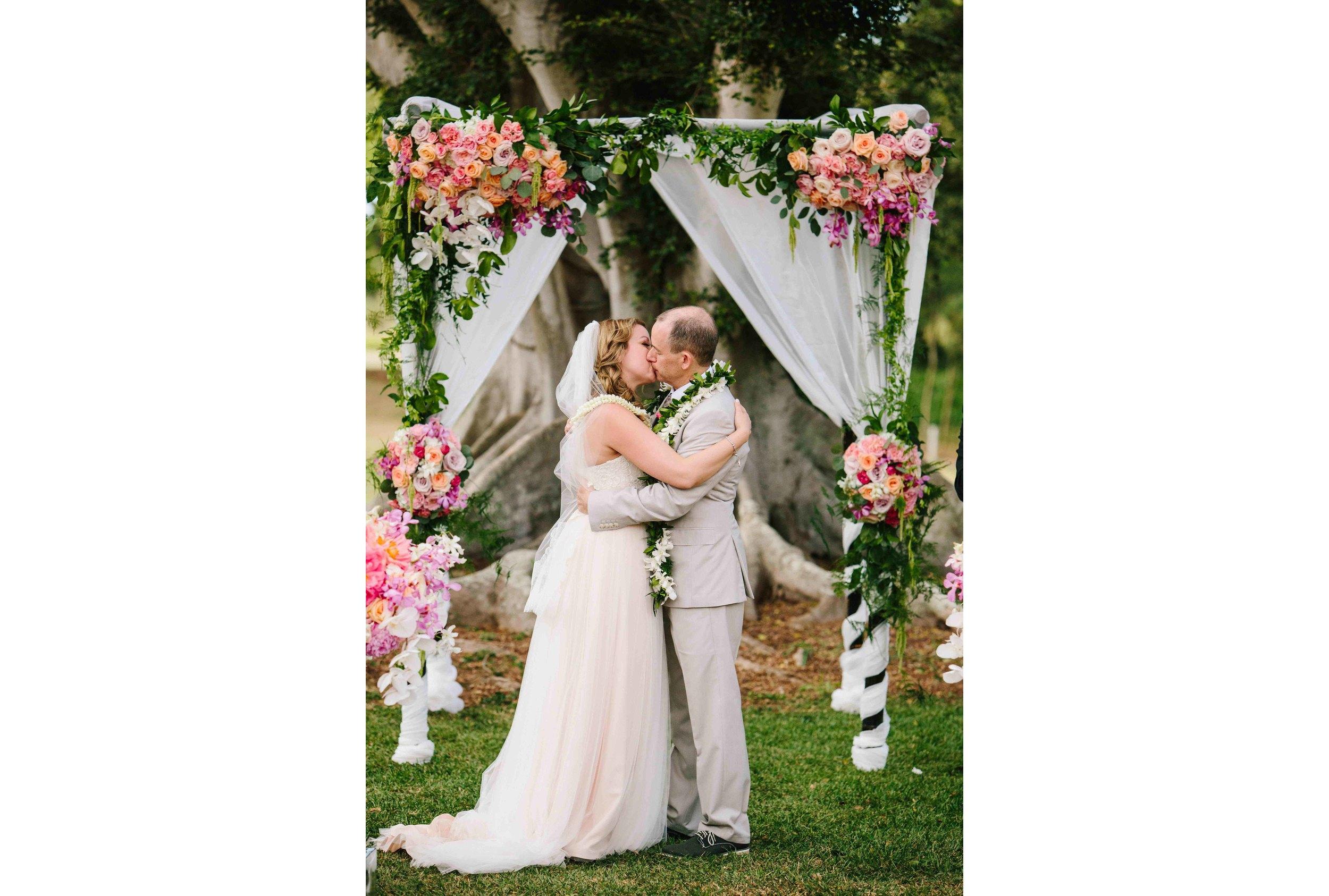 Kiss Beneath The Wedding Arch