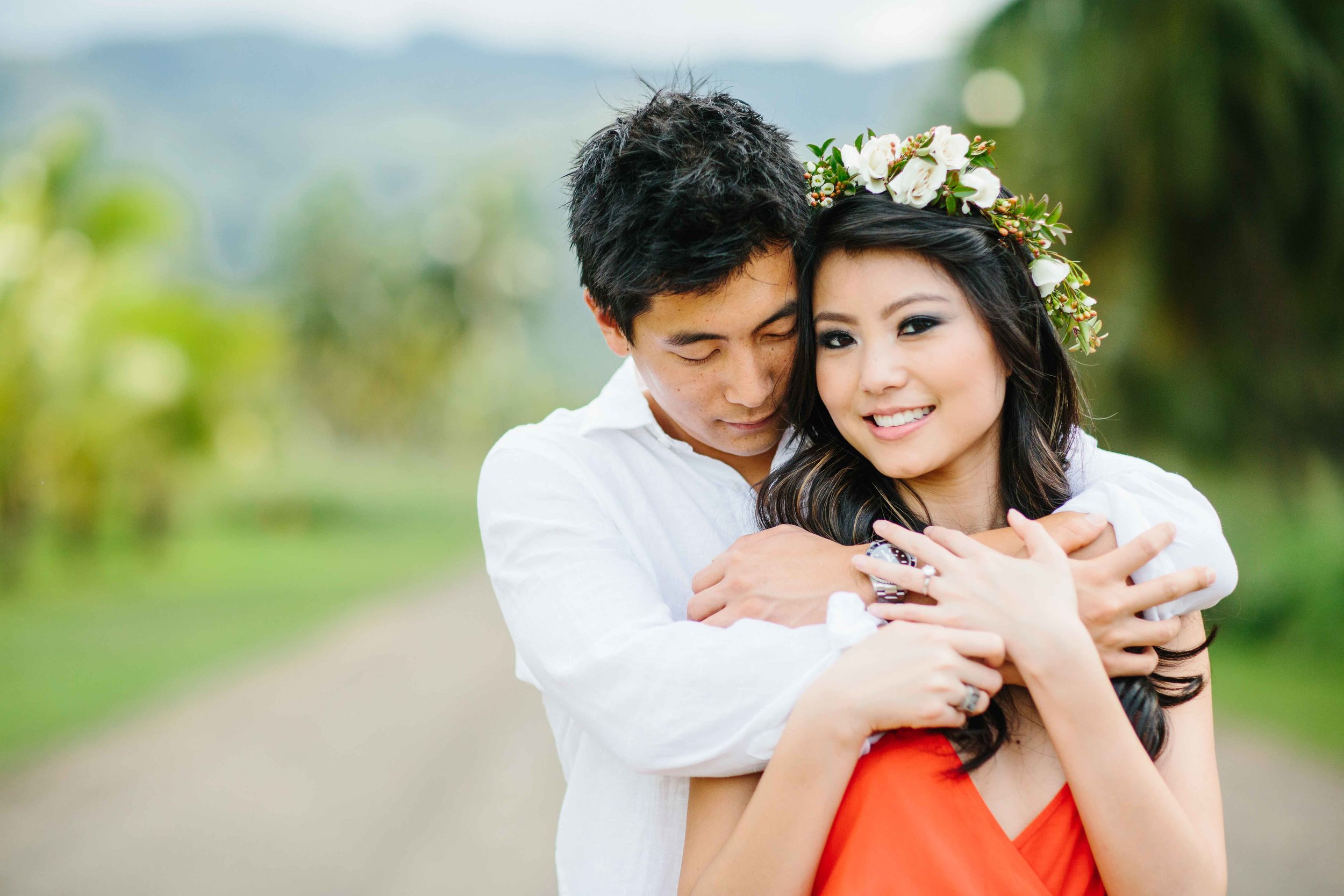Up close and personal with these love birds.  Posed at Dillingham ranch.  Bride has a little hawaiian flower haiku on her head.  both of them holding each other in love.