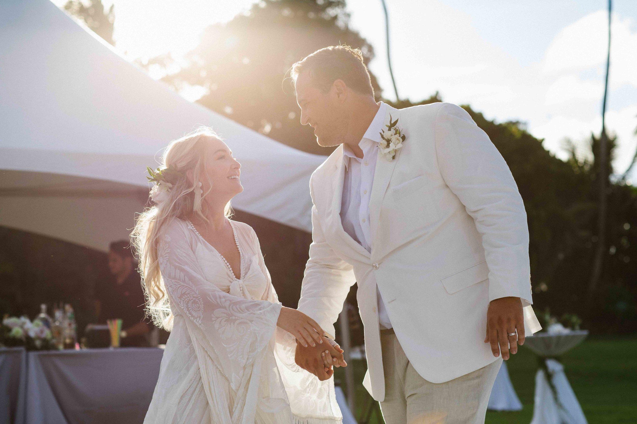 Backlit Wedding Photography of Bride and Groom
