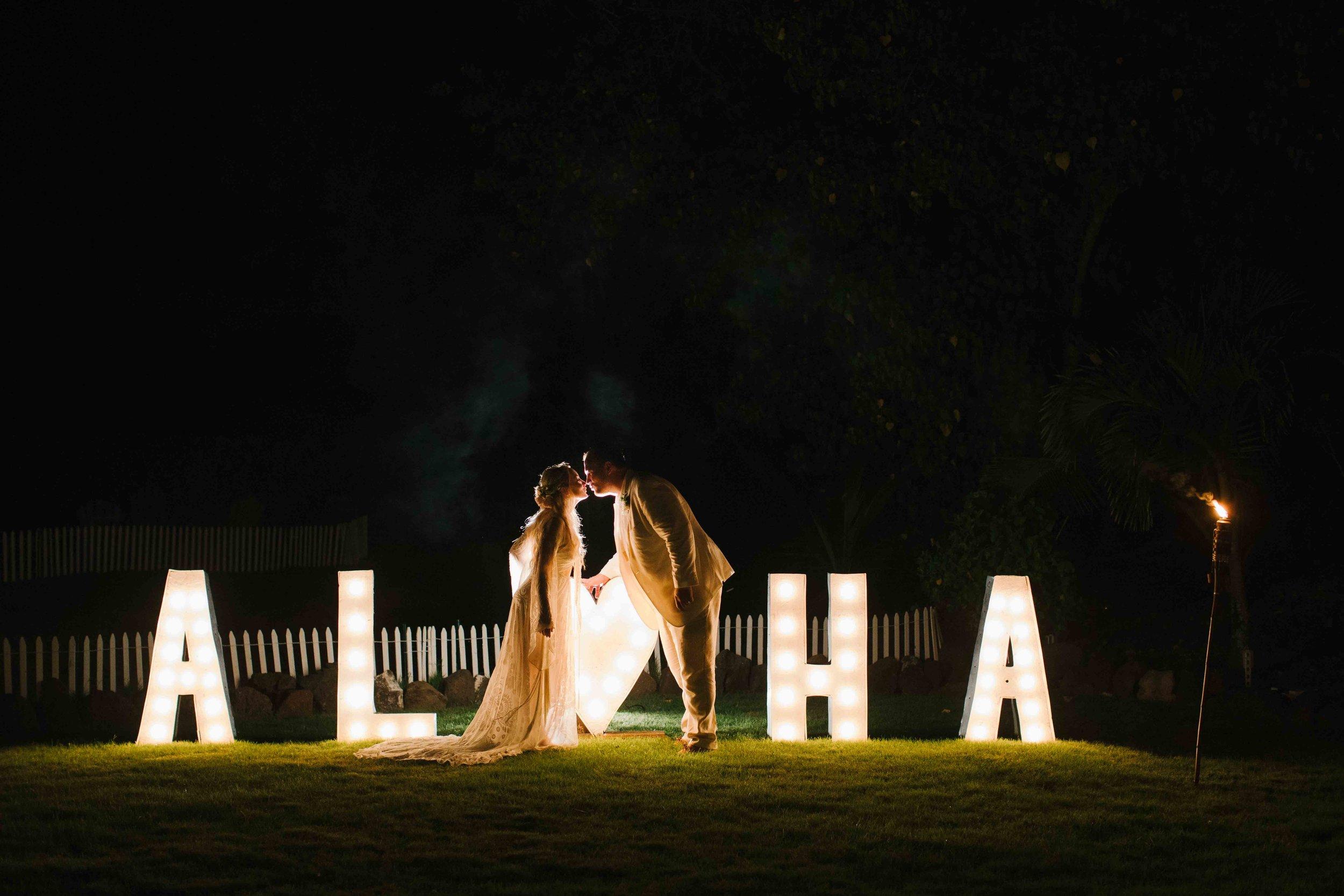 Bride and Groom Kissing with Aloha