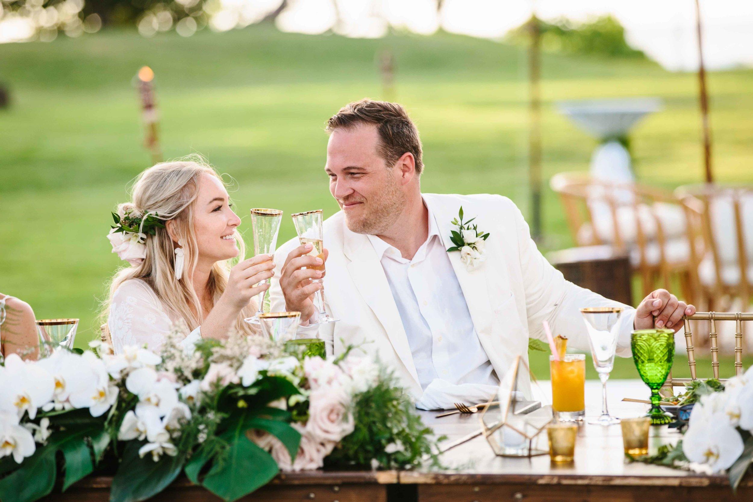 Bride and Groom Toasting at Hawaii Wedding Reception