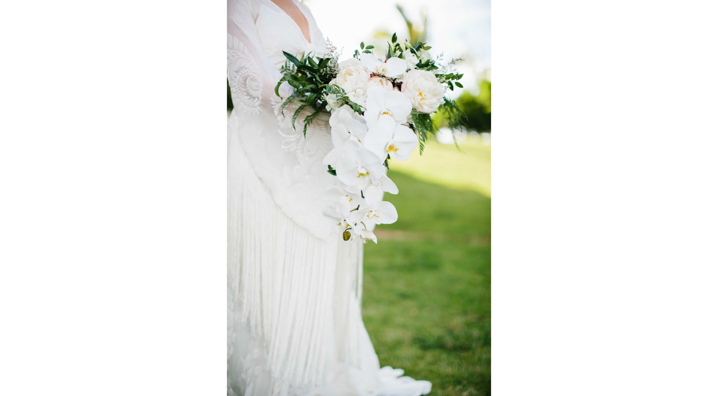 Bridal Bouquet of White Orchids and Greenery