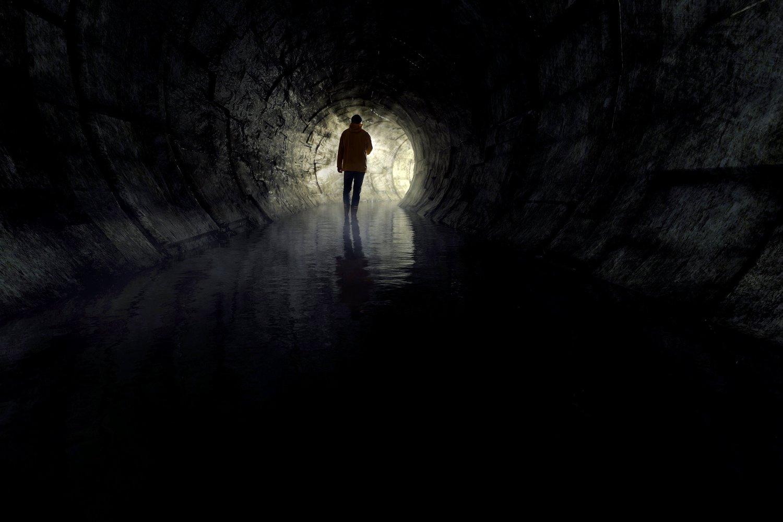 Man-walking-through-tunnel-life-navigation.jpg