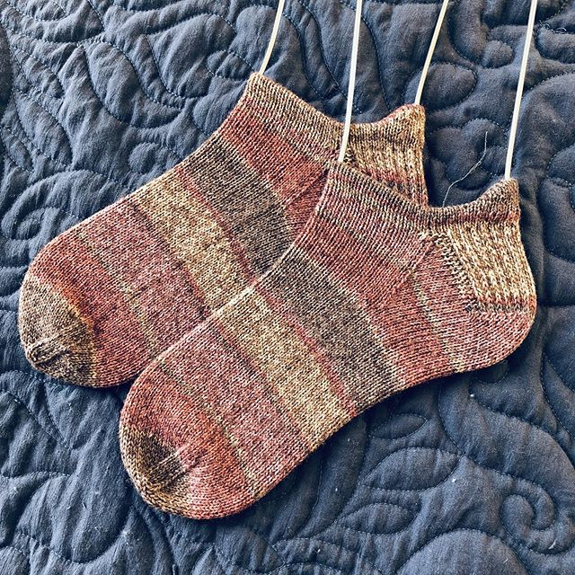 "Just finished my first pair of ""work socks"" here in AL! These have lived in my desk drawer since the start of the year and I get a few rows done when I'm in meetings or debugging code. The stripes matching up after the gusset was 100% coincidence too... 🙃"