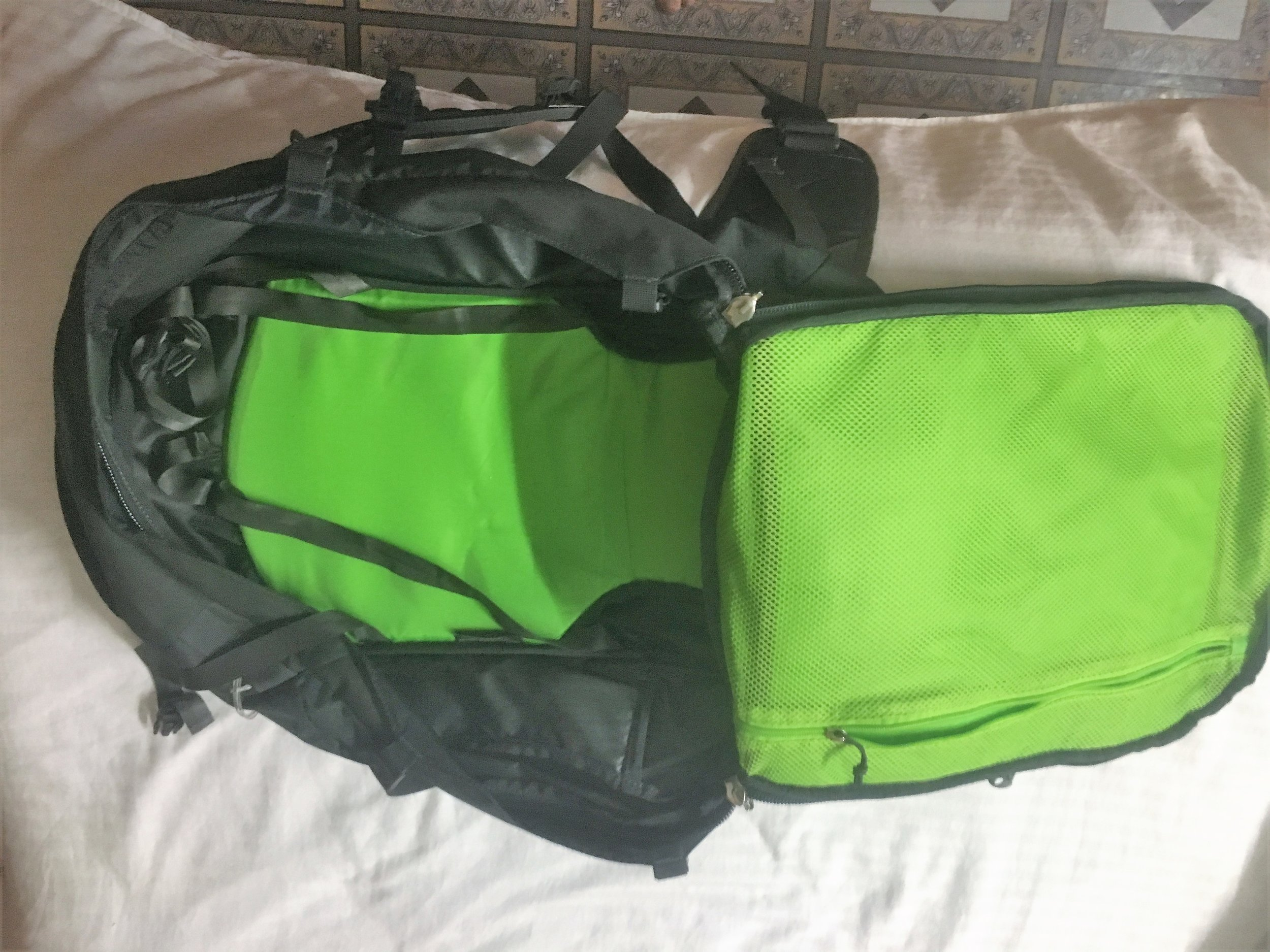 Th bag unzipped showing the main compartment