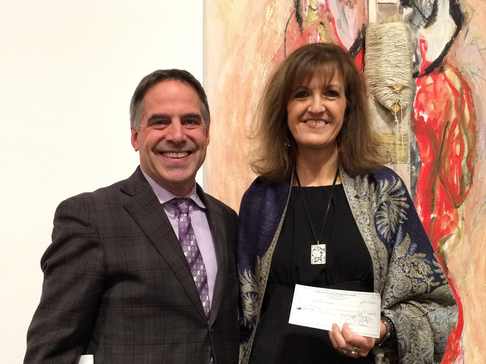 Christie Grace receives the Don S. Williams grant from City of North Vancouver Mayor Darrell Mussatto.