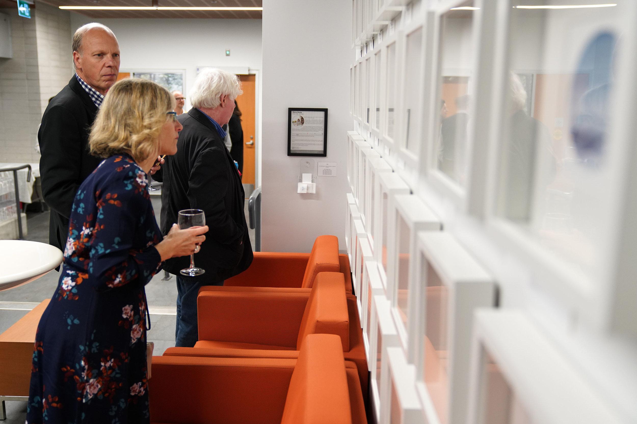 FANS Sponsor Stan Van Woerkens and guests view the art display