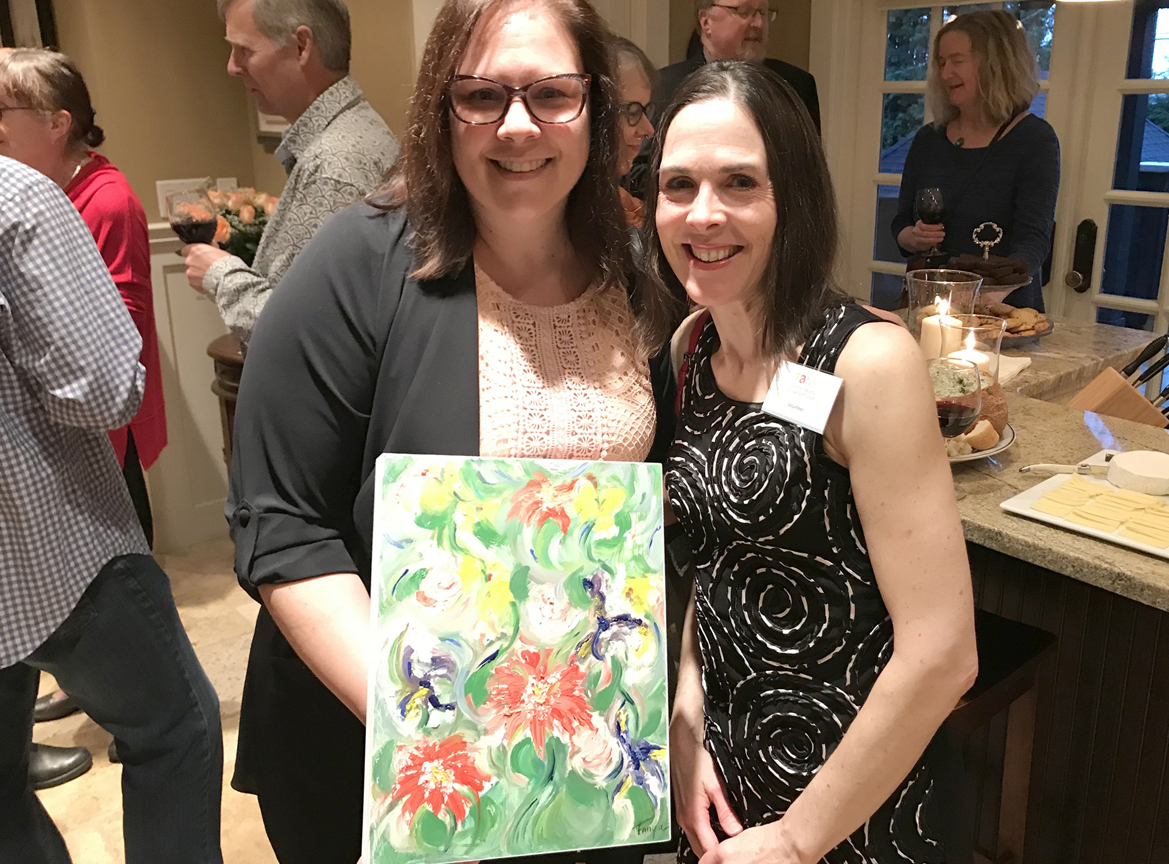 Artist Tanya Vipond (Right) with her painting purchased by appreciative guest