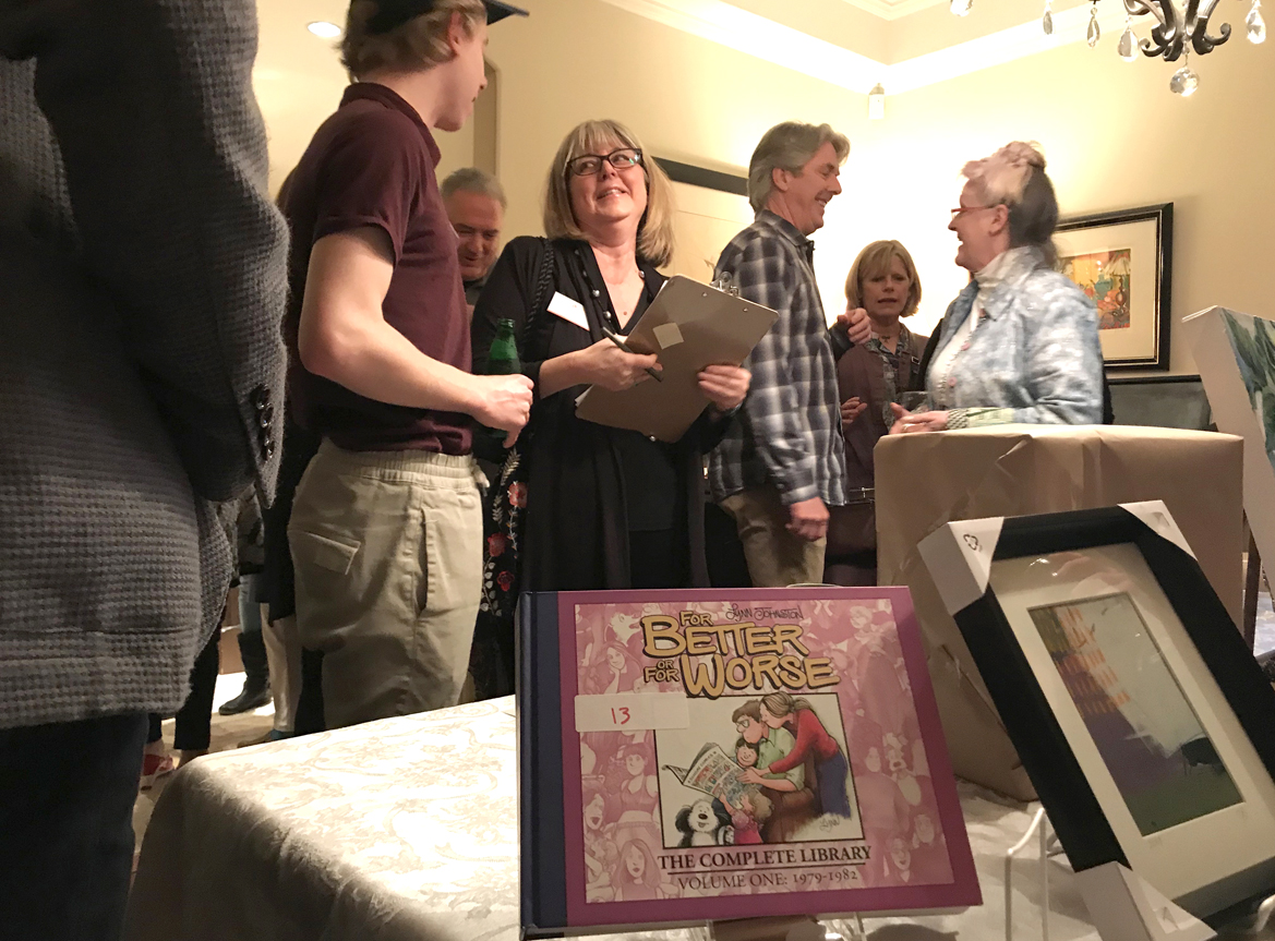 """Book by Lynn Johnston on display from """"Mystery Art Sale"""""""