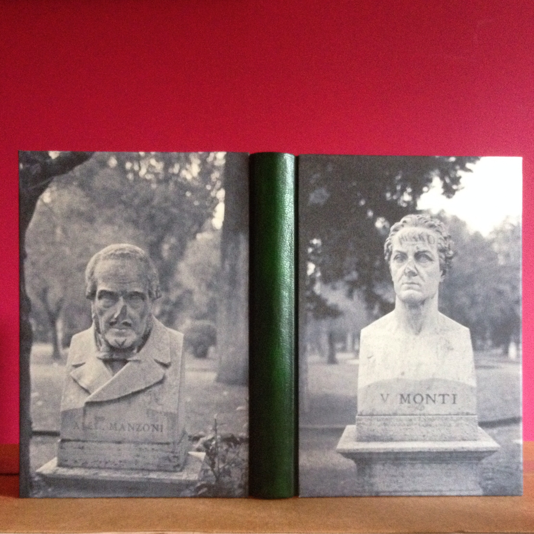A completed Bradel Binding. Quarter bound with leather and archivally printed photographs taken during a trip to Rome