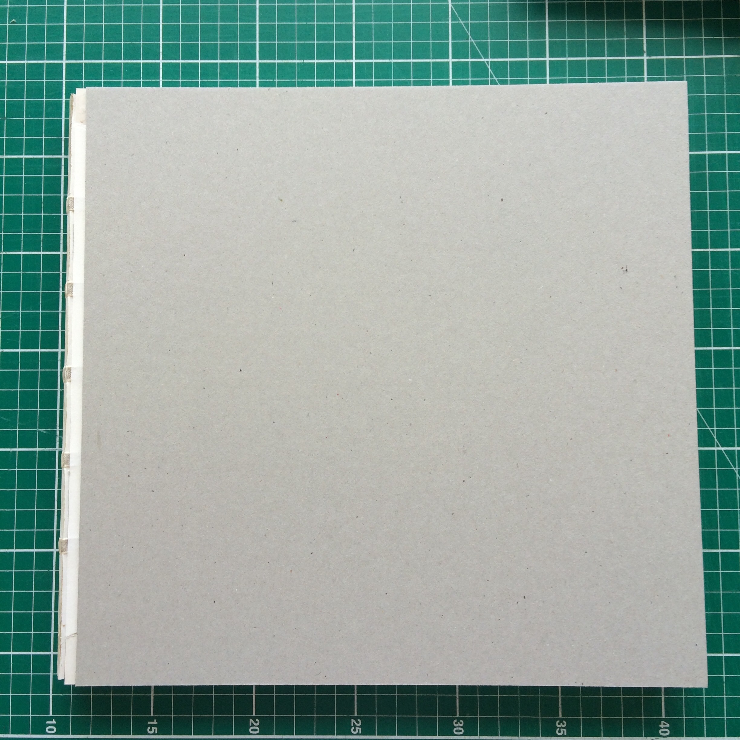 Cover boards attached to the text block.