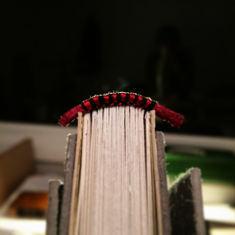 Endband sewn on a leather core