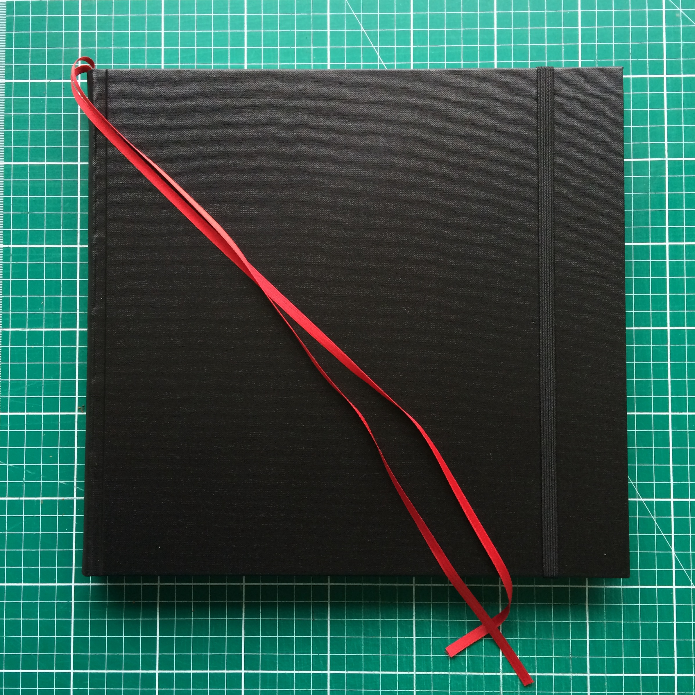 The completed binding with elasticated strap and buckram covering.