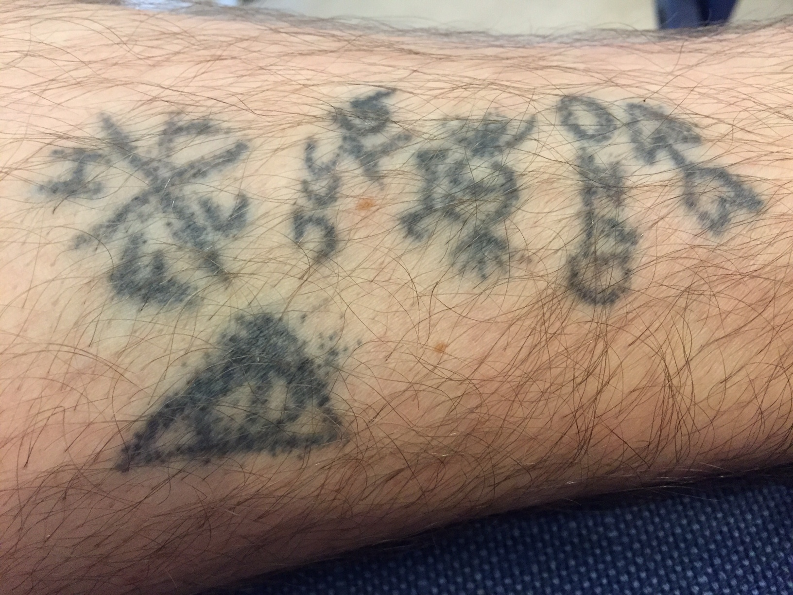 My Charlie Kelly chicken scratch stick'n'poke tattoos, complete with a poorly drawn Deathly Hallows.