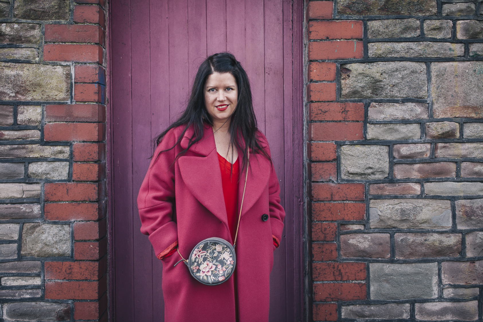 Coat by Jigsaw. Bag by Accessorize. Dress by Boden.