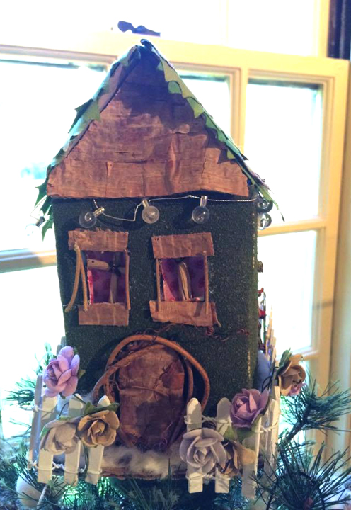 A brilliant fairy house! I am sure there is a little fairy angel in there.