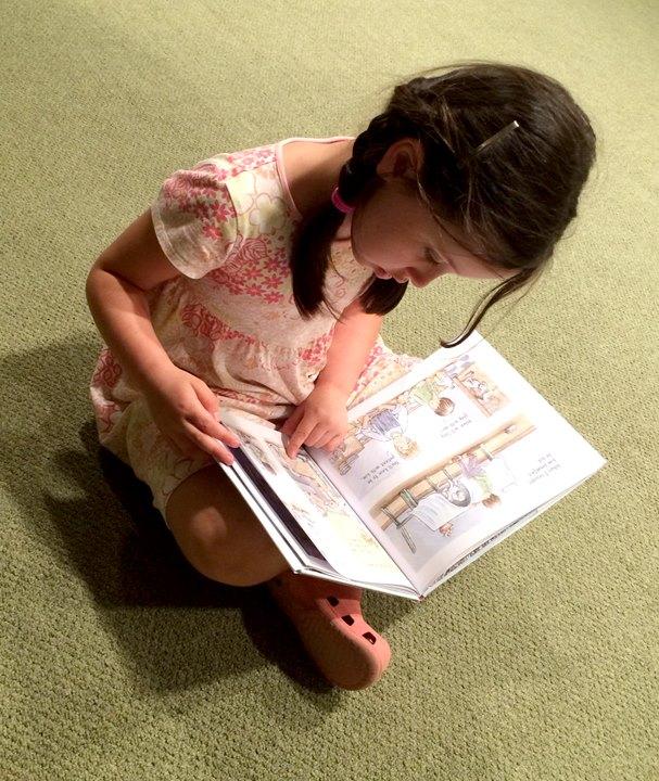 Girl reading Toby.jpg