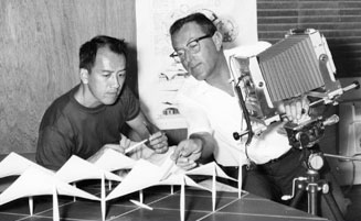 In the 1950s, Leland Y. Lee (left) assists Julius Shulman (right)